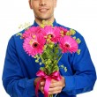 Man holds pink Gerbera flowers — Stock Photo #64471769
