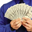 Businessman with money in hands — Stock Photo #64633583