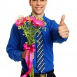 Man holds pink Gerbera flowers — Stock Photo #64821639
