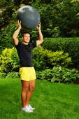 Man with fitness ball behind the head — Stock fotografie