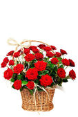 Beautiful red roses in a basket — Stock Photo