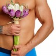 Muscular man holds bouquet of tulips — Stock Photo #66998313