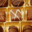 Tasty chocolate candies in a box — Stock Photo #78041792