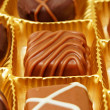 Tasty chocolate candies in a box — Stock Photo #78041812
