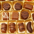 Tasty chocolate candies in a box — Stock Photo #78041796