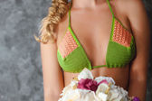 Bosom of blonde model in knitted bikini — Stock Photo
