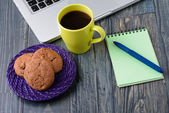 Notebook with notes, coffee and biscuits — Stock Photo