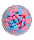 Tablets, capsules in the glass — Stock Photo