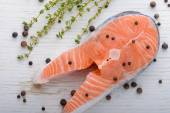 Fresh salmon with pepper and thyme — Stok fotoğraf
