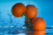 Fresh tomato in water — Stock Photo