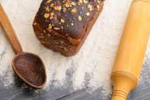 Bread with a spoon and a rolling pin on the table — Stockfoto