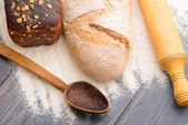 Bread on the table with flour — Stockfoto