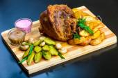 Roasted pork shank with potatoes  — Stock fotografie