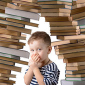 Little boy with a stack of books — Stock Photo