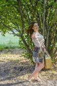 The girl with a suitcase against park — Stock Photo