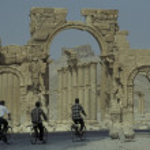 People riding bicycle near Roman Ruins — Stock Photo #73296935