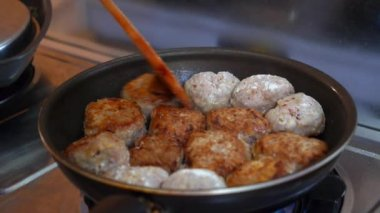 Close up of Female Hands Turning Meat Cutlets in a Frying Pan. — Stock Video