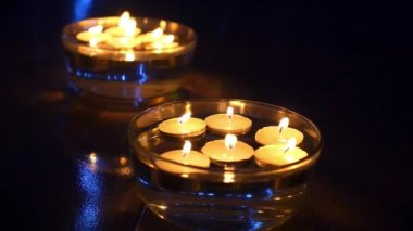 Lighting Candles in Water with Blue Lights in Darkness — 图库视频影像