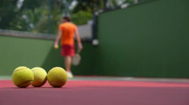 Tennis Player Playing on Court with Tennis Balls. — Stock Video
