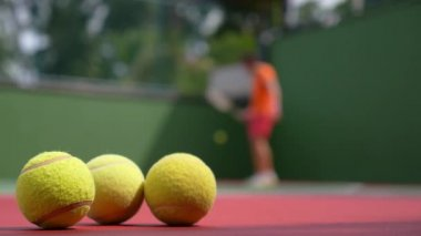 Close up View of Tennis Racket and Balls on Clay Tennis Court. — Stock Video