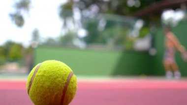 Tennis Ball on Court Close up with Tennis Player Background. — Stock Video