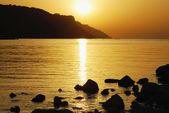 Orange sunset on the beach — Stock Photo