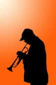 Lone musician with horn — Stok fotoğraf