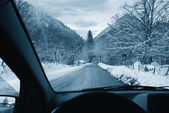 Driving on snowy road — Stock Photo