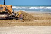 Bulldozer in the sand — Stock Photo
