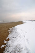 Beach covered by snow — Stock Photo