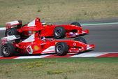 Ferrari overtaking — Stock Photo