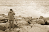 Photographer over the cliff — Stock Photo