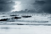 Lightning over the sea in winter — Stock Photo