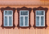 Russia. Suzdal. Three windows with carved wooden frames. — Stockfoto