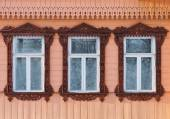 Russia. Suzdal. Three windows with carved wooden frames. — Stock Photo