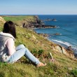 Woman looking out to sea side view — Stock Photo #74930507