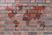 Red Brick wall texture with world map — Stock Photo