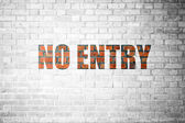 Red Brick wall texture with a word No Entry — Fotografia Stock
