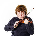 Big fat red-haired boy with small violin — Stock Photo