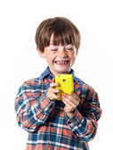 Red-haired funny boy with mobile phone — Stock Photo