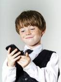 Emotional red-haired boy with mobile phone — Stock Photo