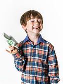 Happy red-haired boy with money — Stock Photo