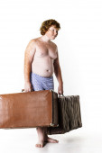 Undressed red-haired boy with old suitcases — Stock Photo
