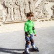 Little preschooler boy learning rollerskating — Stock Photo #52791309