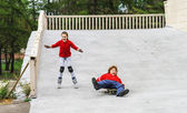 Group of children rollerskating in public park — Stock Photo