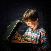 Little boy finding treasure — Stock Photo