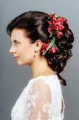 Beautiful bride with fashion wedding hairstyle — Foto de Stock