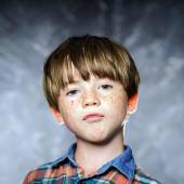 Emotional portrait of red-haired boy — Stock Photo