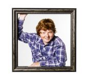 Red-haired boy posing with picture frame — Stock Photo