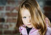 Cute little girl studio portrait — Stock Photo